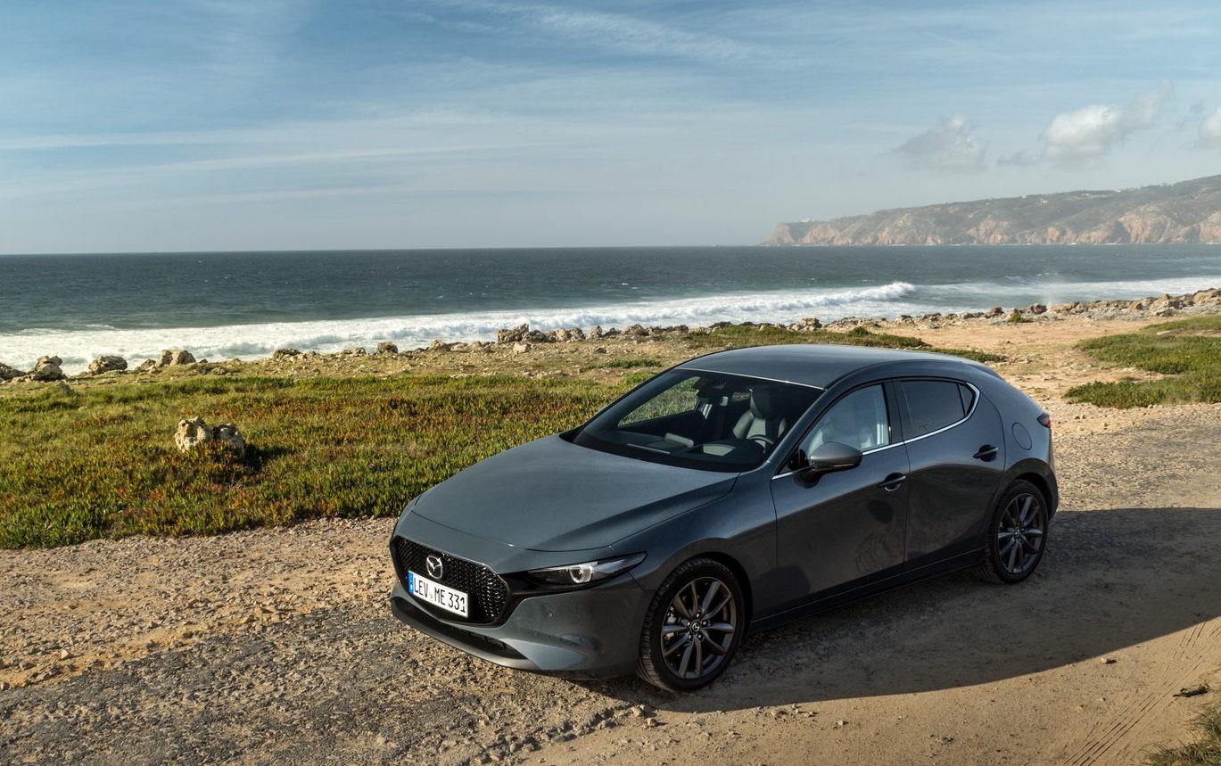 Mazda 3 фото вид спереди